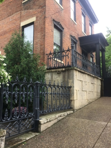 House on Bench Street with wrought iron fence and side garden
