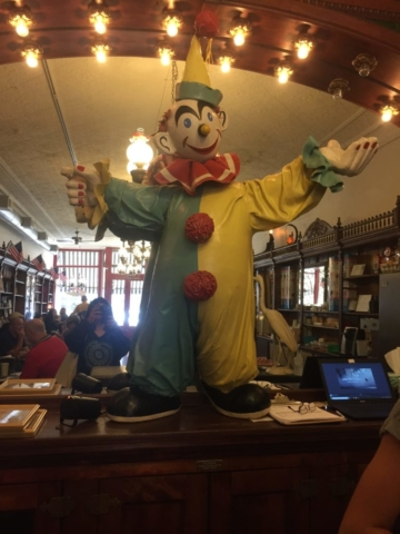 Statue of clown with raise arm inside ice cream parlor galena
